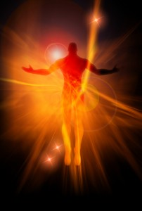 a warm light coming from a human figure showing spiritual empowerment