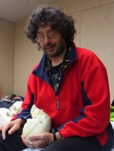 Peter Aziz holding skull used to demonstrate points for cranial healing in Advanced Point Holding Course